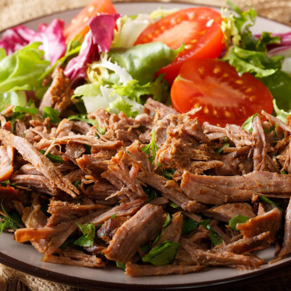 shredded beef in a salad