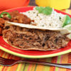 Pork Carnitas served with beans and rice